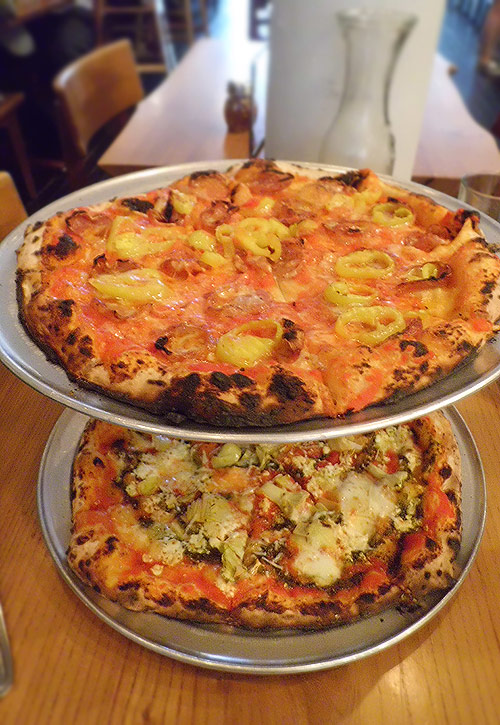 Soppressata and Artichoke pizzas from A Tavola
