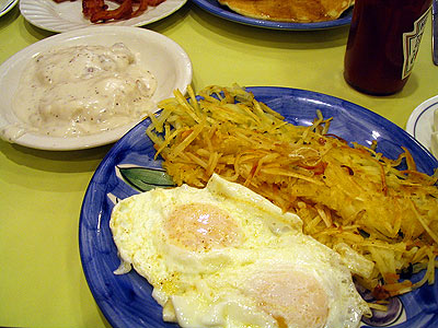 eggs over easy, hash browns and biscuits and gravy