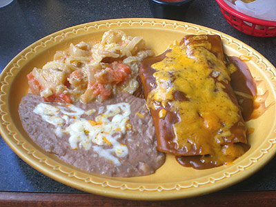 Chicken and Beef Enchiladas with potatoes and refried beans at Jalapeno's Mex Mex