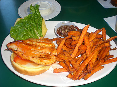 Buffalo Chicken sandwich with Sweet Potato Fries and Calypso Sauce