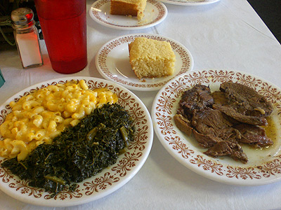 Jerk lamb w/mac & cheese and greens